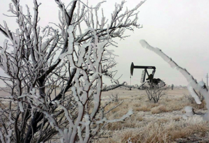 West Texas pump jack in winter scene